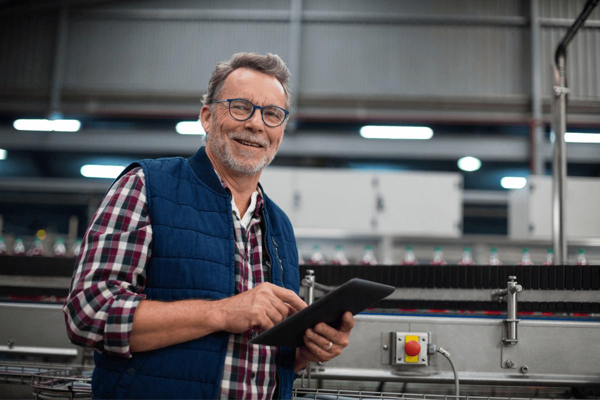 older adult make in a flannel shirt and blue vest