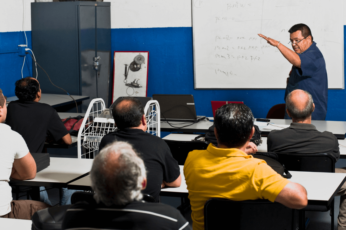 instructor at the front of a classroom of older adults