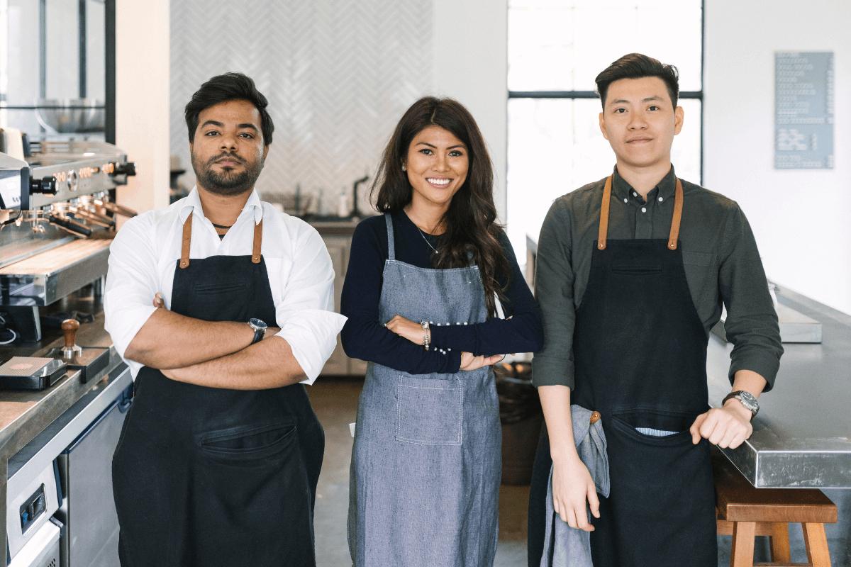 three diverse chefs in a kitchen