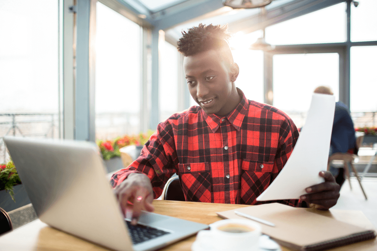 young African American man working on a laptop