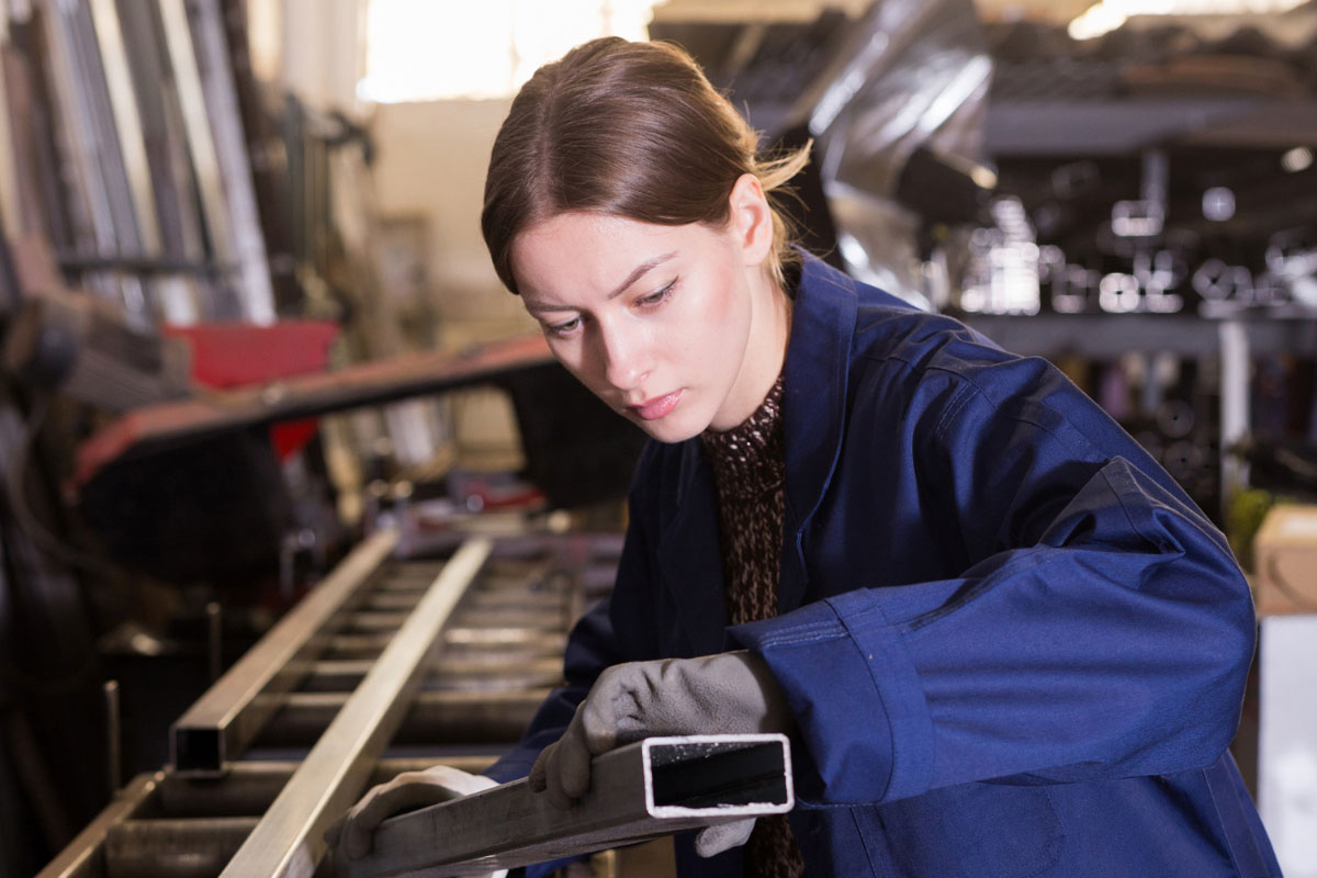 young woman working on an assembly line