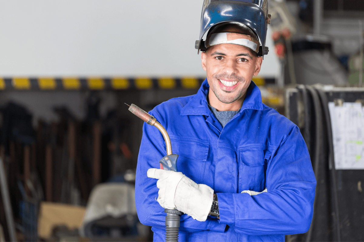 young male welder