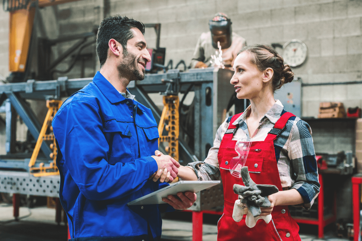 male and female factory worker talking